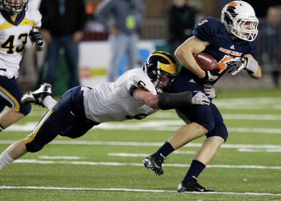 Bellevue's Sean Constantine (6) tackles Eastside Catholic's Colin Boit (5) after Boit made a catch in the first half of the 3A division high school state championship football game, Friday, Nov. 30, 2012, in Tacoma, Wash. Photo: Ted S. Warren / Associated Press