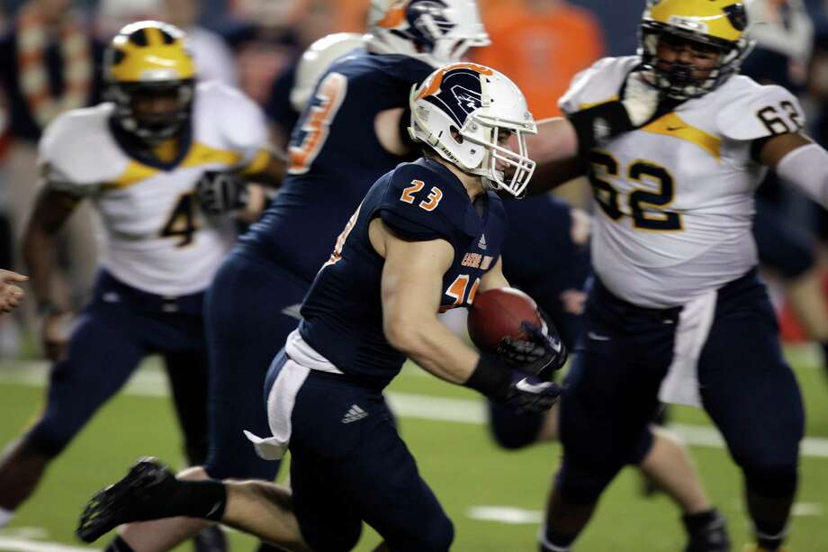 Eastside Catholic's Henry Jarvis (23) rushes the ball against Bellevue in the first half of the 3A division high school state championship football game, Friday, Nov. 30, 2012, in Tacoma, Wash. Photo: Ted S. Warren / Associated Press