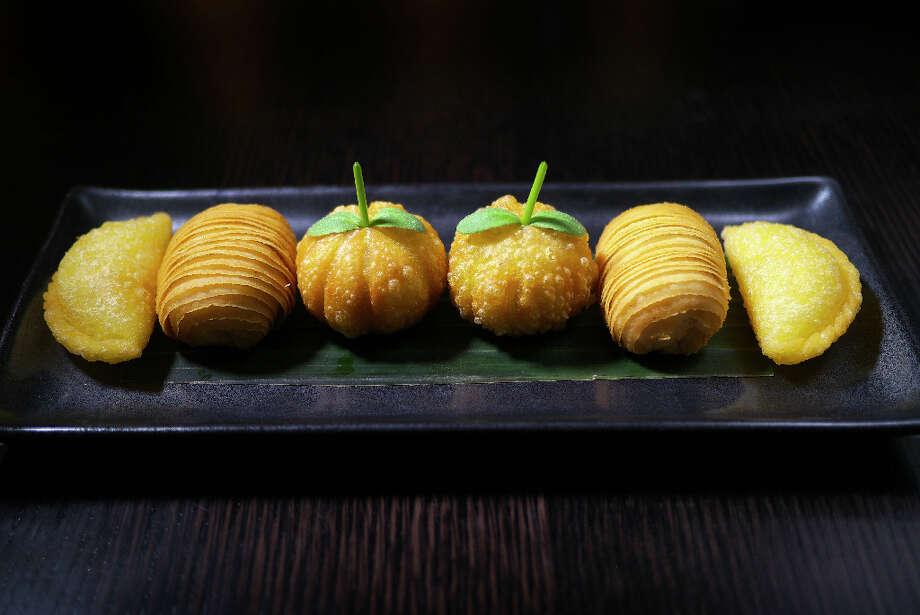 Hakka fried dim sum platter: roasted duck and pumpkin puff, crispy prawn dumpling, XO scallop puff ($20)