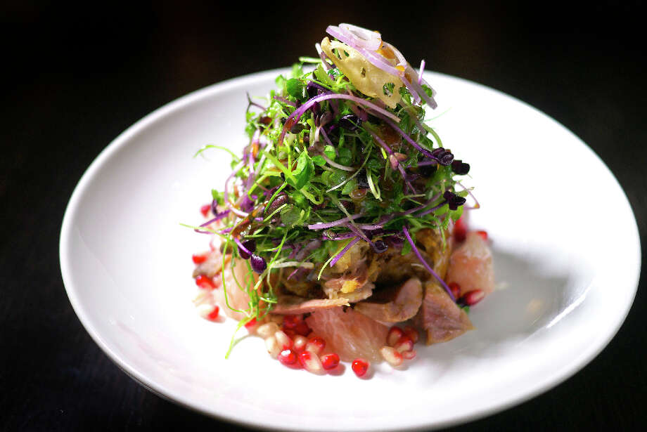 Crispy duck salad with pomegranate, pine nut and shallot ($28)
