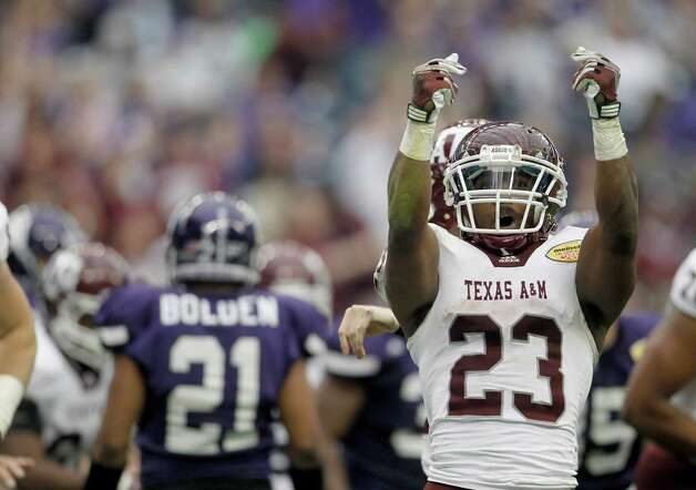 Texas A&M Aggies running back Ben Malena (23) celebrates his touchdown during the second quarter of the Meineke Car Care Bowl at Reliant Stadium,Saturday, Dec. 31, 2011, in Houston. Photo: Karen Warren, Houston Chronicle / © 2011 Houston Chronicle