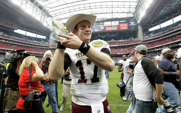 Texas A&M Aggies quarterback Ryan Tannehill (17) who was named MVP holds his trophy and wears his cowboy hat after the Meineke Car Care Bowl at Reliant Stadium,Saturday, Dec. 31, 2011, in Houston.  Texas A&M won the game against Northwestern University 33-22. Photo: Karen Warren, Houston Chronicle / © 2011 Houston Chronicle