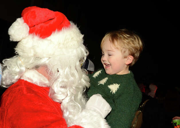 Ben Warren, 3, of Rowayton, greets Santa at the annual Light up Rowayton holiday town lighting at Pinkney Park in Rowayton on Sunday, Dec. 2, 2012. Photo: Amy Mortensen / Connecticut Post Freelance
