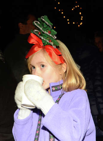 Sawyer Woodruff, 5, of Rowayton, sips on a cup of hot cocoa during the annual Light up Rowayton holiday town lighting at Pinkney Park in Rowayton on Sunday, Dec. 2, 2012. Photo: Amy Mortensen / Connecticut Post Freelance