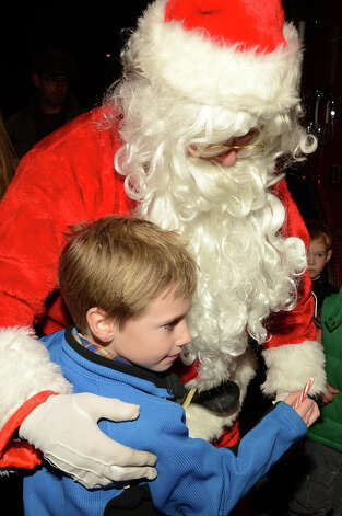 John Schneider, 7, of Rowayton, hugs Santa during the annual Light up Rowayton holiday town lighting at Pinkney Park in Rowayton on Sunday, Dec. 2, 2012. Photo: Amy Mortensen / Connecticut Post Freelance