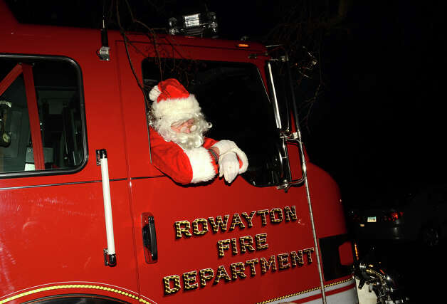 Santa arrives by firetruck during the annual Light up Rowayton holiday town lighting at Pinkney Park in Rowayton on Sunday, Dec. 2, 2012. Photo: Amy Mortensen / Connecticut Post Freelance