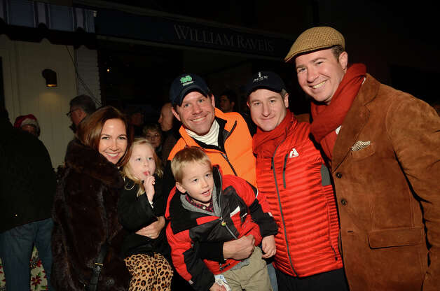 Ted Hildner, of the RCA, poses for a photo with the Landsness family, of Rowayton, during the annual Light up Rowayton holiday town lighting at Pinkney Park in Rowayton on Sunday, Dec. 2, 2012. Photo: Amy Mortensen / Connecticut Post Freelance