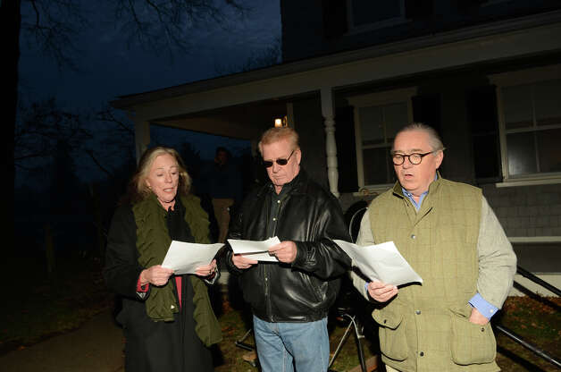 Val Palmer and her husband, Pete Palmer, of Palm Springs, California sing Christmas carols with Patrick Steele, of the Rowayton Civic Association, during the annual Light up Rowayton holiday town lighting at Pinkney Park in Rowayton on Sunday, Dec. 2, 2012. Photo: Amy Mortensen / Connecticut Post Freelance