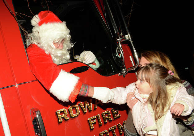 Reese Salmore, 2, of Rowayton, shakes hands with Santa during the annual Light up Rowayton holiday town lighting at Pinkney Park in Rowayton on Sunday, Dec. 2, 2012. Photo: Amy Mortensen / Connecticut Post Freelance