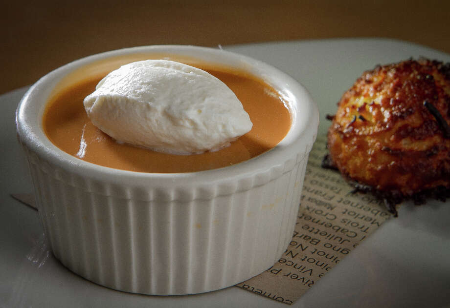 Dessert (all $7) includes a homey butterscotch pudding with an overly moist coconut macaroon... Photo: John Storey, Special To The Chronicle / John Storey