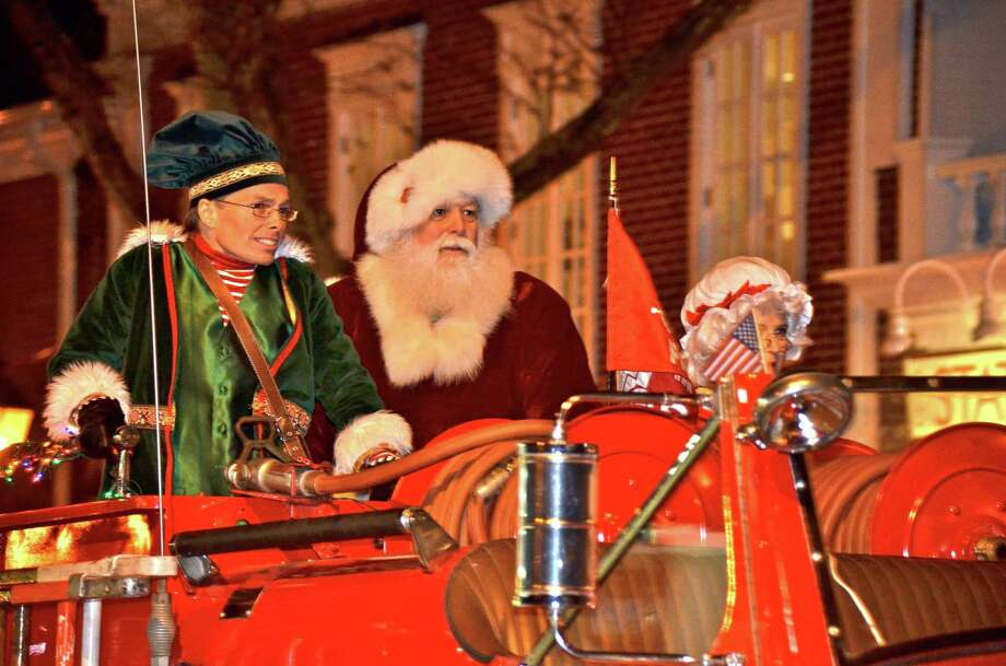 Santa, Mrs. Claus and Santa's elf arrive in style at the Holiday Stroll Friday night.  Nov. 30, 2012, New Canaan, Conn. Photo: Jeanna Petersen Shepard