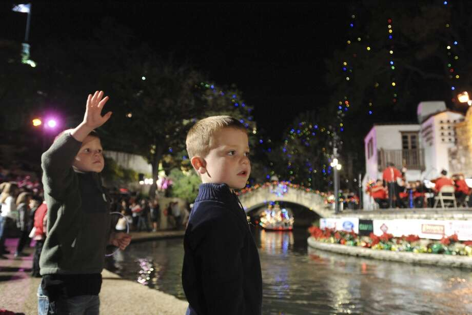 The new LEDs are barely recognizable in the background of this shot from this year's Ford Holiday River Parade. (BILLY CALZADA / SAN ANTONIO EXPRESS-NEWS)