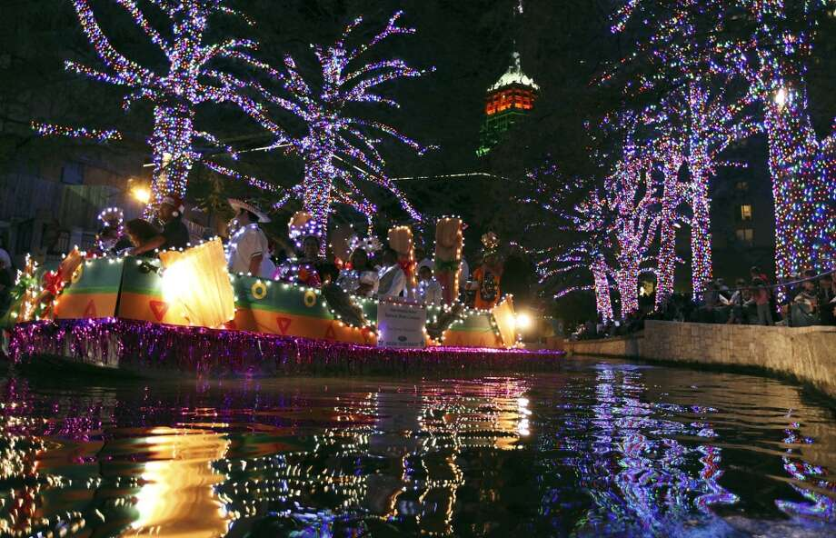 The tree-wrapped LEDs that were introduced in 2011 during the Ford Holiday River Parade. (EDWARD A. ORNELAS/SAN ANTONIO EXPRESS-NEWS)