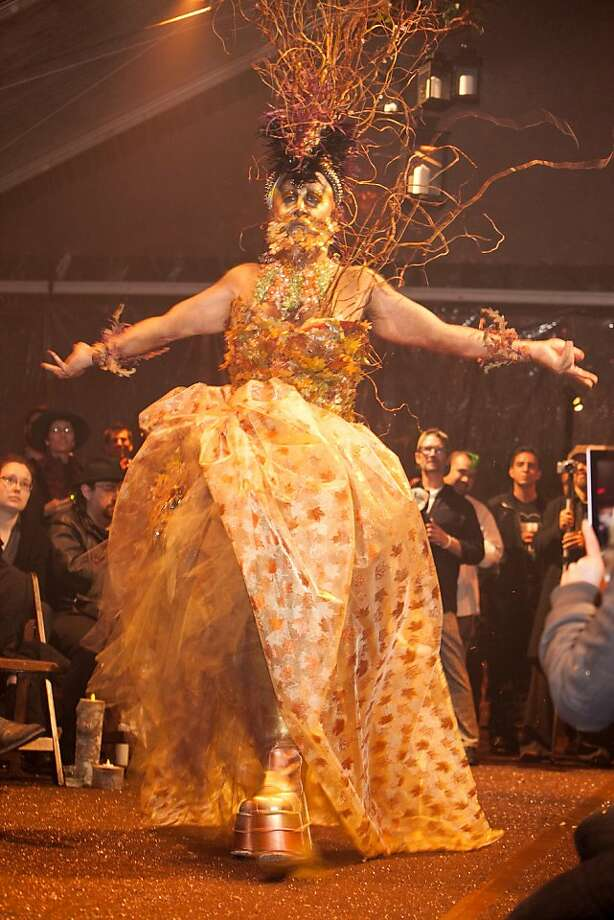 """The Sisters of Perpetual Indulgence hosted their fourth """"Project Nunway"""" fashion show fundraiser in San Francisco on Dec. 2, 2012, capping World AIDS Day weekend with a riotous display of creativity for a cause. Some 22 contestants and their designers (charged with using recycled materials) competed for the title and a gift basket from Kryolan, with the theme of """"Flora."""" Sister Tilly Comes Again emerged the winner, with a costume called """"Autumn Leaves You Breathless,"""" with a mohawk-style headpiece that towered 10 feet in the air, which she designed with construction assistance from construction assistance by friends Ross Caperton and Sister Pat N Leather. The event was conducted in a tent at the National AIDS Memorial Grove in Golden Gate Park, and included a performance by rap duo Double Duchess and Honey Mahogany, a contestant on TV reality show """"RuPaul's Drag Race."""" The nuns are a queer order established in 1979 to fight for human rights and against religious intolerance using humor and art as tools. Photo: Drew Altizer Photography"""