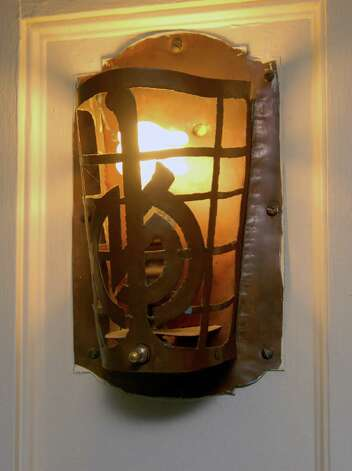 A light fixture that composer Deems Taylor and wife Mary Kennedy installed with their initials in the bedroom of the Haviland Rd home in Stamford, Conn. that  Col Stone and Ann Jasperson now own on Monday December 3, 2012. Photo: Dru Nadler / Stamford Advocate Freelance