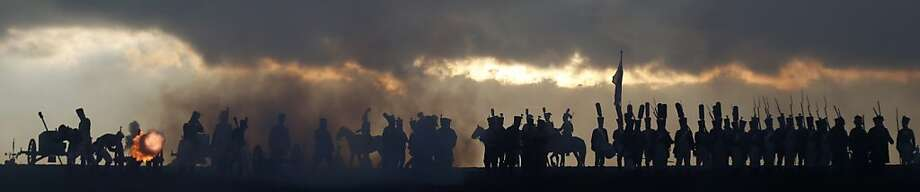 History enthusiasts dressed as soldiers form a battle line during a re-enactment of the 1805 Battle of Austerlitz, one of Napolean's greatest victories, near the South Moravian city of Slavkov, Czech Republic. Photo: Petr David Josek, Associated Press