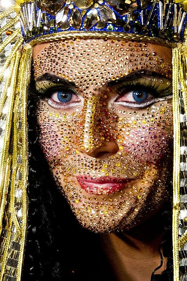For the glitterati only:Heidi Klum, as Cleopatra, invited all sorts of celebrities to her superstorm-delayed Haunted Holiday Party in New York, but no one shone more than she did. Photo: Charles Sykes, Associated Press