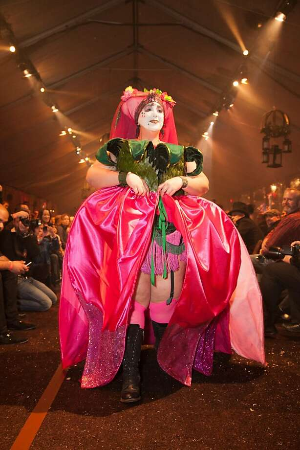 "Sister Connie Pinko wears an original design by Ruby Vixen called ""Tiptoe Through the Tulips."" It was composed of recycled fabric from Scrap SF and the East Bay Depot for Creative Reuse, and took two months to create. The full skirt was removed on the runway with a grand flourish to show a daring shorter skirt underneath. Photo: Drew Altizer Photography"