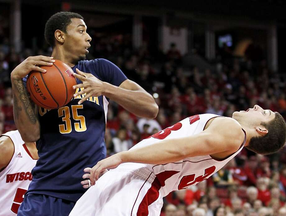 Pardon my pointy elbow: Cal's Richard Solomon knocks over Wisconsin's Zak Showalter, earning the Bears player a technical foul. Wisconsin won 81-56. Photo: Andy Manis, Associated Press