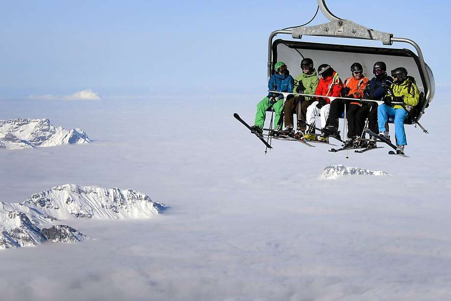 Above the clouds:Skiers ride a chairlift on Titlis Mountain above Engelberg, Switzerland. Photo: Fabrice Coffrini, AFP/Getty Images