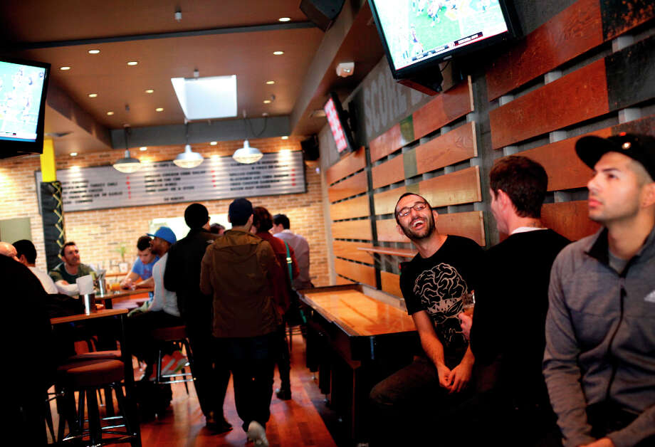 Ash Ahmad, of San Francisco, enjoys the atmosphere at Hi Tops. Photo: Sarah Rice, Special To The Chronicle / ONLINE_YES