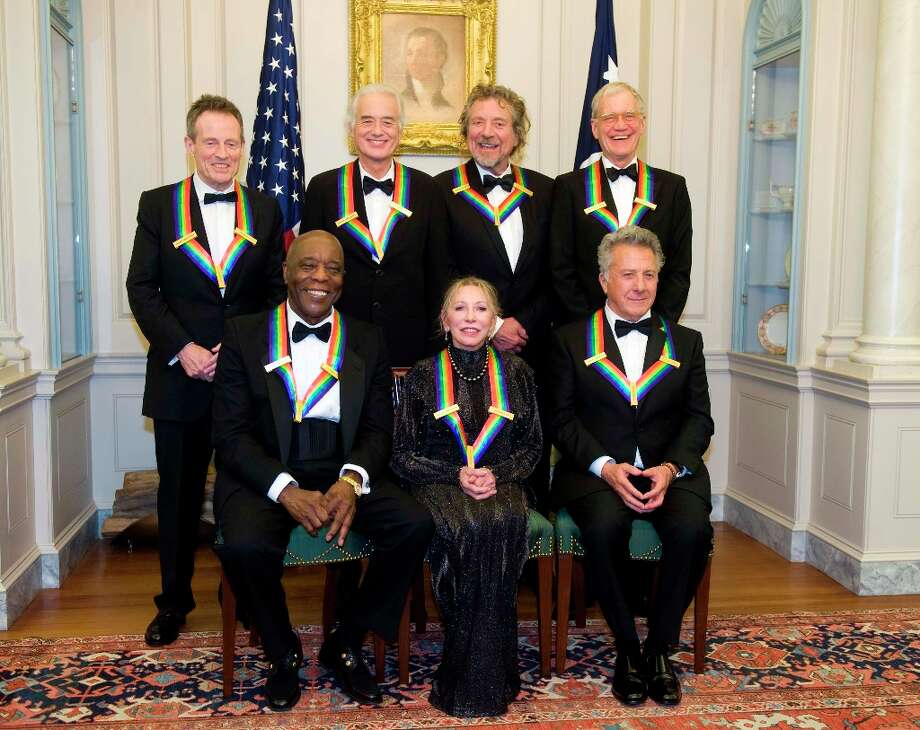 The 2012 Kennedy Center Honorees, from left, John Paul Jones, Buddy Guy, Jimmy Page, Natalia Makarova, Robert Plant, Dustin Hoffman, and David Letterman pose for a group photo after the State Department Dinner for the Kennedy Center Honors gala Saturday, Dec. 1, 2012 at the State Department in Washington. (AP Photo/Kevin Wolf) Photo: Kevin Wolf, Associated Press / FR33460 AP