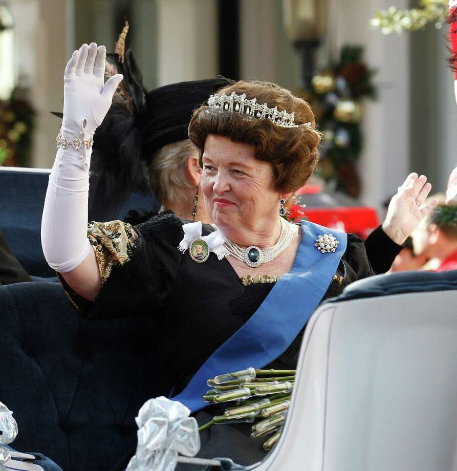 Anne Boyd as Queen Victoria waves to the crowd during The Queen's Parade at the 39th annual Dickens on The Strand festival, Saturday, Dec. 1, 2012 in Galveston, Texas. The Galveston Historical Foundation recreated the Victorian London of Charles Dickens for the annual holiday event. (AP Photo/The Galveston County Daily News, Kevin M. Cox) MANDATORY CREDIT; TV OUT Photo: Kevin M. Cox, MBR / The Galveston County Daily News