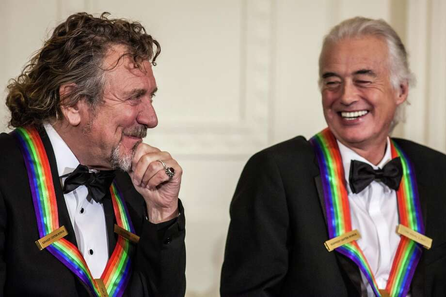 Robert Plant (L) and Jimmy Page of the band Led Zeppelin attend the Kennedy Center Honors reception at the White House on December 2, 2012 in Washington, DC. (Photo by Brendan Hoffman/Getty Images) Photo: Brendan Hoffman, Getty Images / 2012 Getty Images