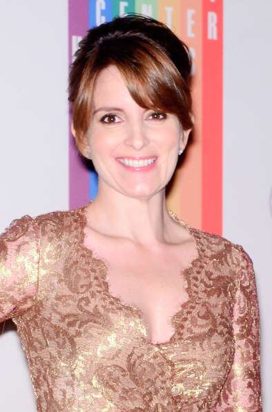 Tina Fey poses for photographers during the 35th Kennedy Center Honors at the Kennedy Center Hall of