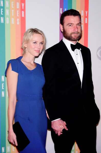 Naomi Watts and Liev Schreiber pose for photographers during the 35th Kennedy Center Honors at the K