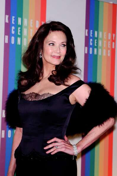 Lynda Carter poses for photographers during the 35th Kennedy Center Honors at the Kennedy Center Hal