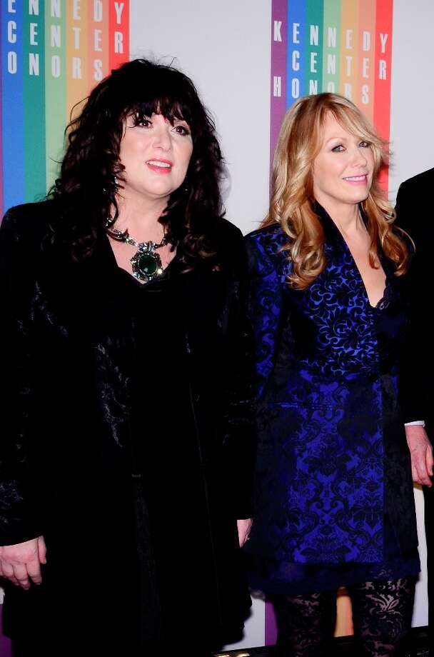 Ann Wilson and Nancy Wilson pose for photographers during the 35th Kennedy Center Honors at the Kennedy Center Hall of States on December 2, 2012 in Washington, DC. (Photo by Kris Connor/Getty Images) Photo: Kris Connor, Getty Images / 2012 Getty Images