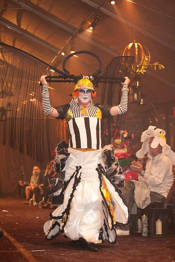 "Sister Anni Coque l'Doo in an original design by Guadalupe ""Lupe"" Martinez, called ""Bird of Paradise."" The black-and-white gown was topped by a headpiece that had black fringe extending outward for several feet from bug-like tentacles. It was her first time competing in the contest and she said she was inspired by ""the location and the theme."" Photo: Drew Altizer Photography"