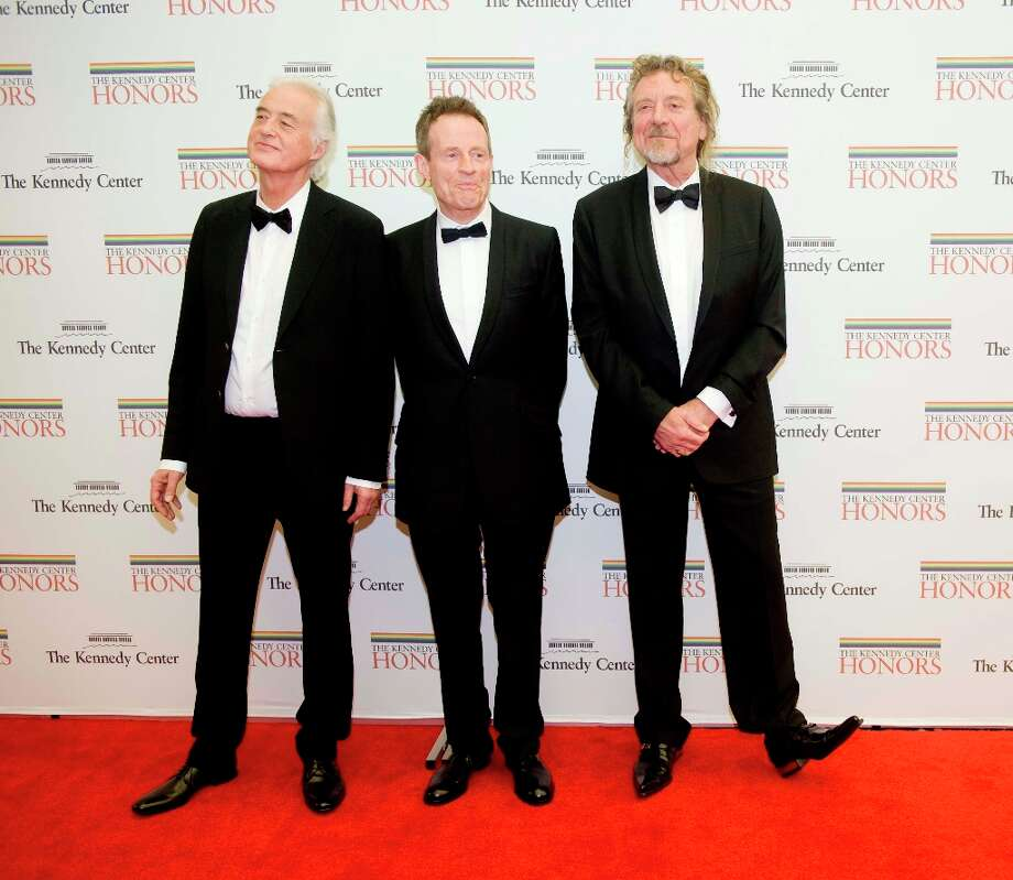 From left, 2012 Kennedy Center Honorees and members of Led Zepplin Jimmy Page, John Paul Jones, Robert Plant arrive at the State Department for the Kennedy Center Honors Gala Dinner on Saturday, Dec. 1, 2012 in Washington. (AP Photo/Kevin Wolf) Photo: Kevin Wolf, Associated Press / FR33460 AP