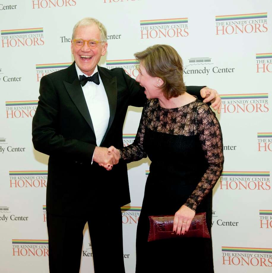 2012 Kennedy Center Honoree comedian David Letterman shakes hands with his wife Regina as they arrive at the State Department for the Kennedy Center Honors Gala Dinner on Saturday, Dec. 1, 2012 in Washington. (AP Photo/Kevin Wolf) Photo: Kevin Wolf, Associated Press / FR33460 AP