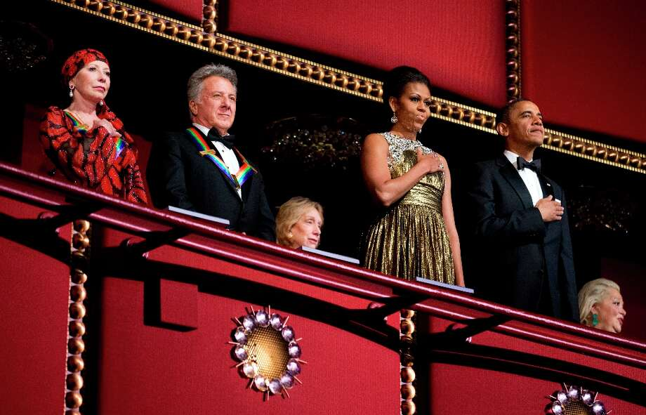 President Barack Obama, right, and first lady Michelle Obama, second from right, with the 2012 Kennedy Center Honors recipients, ballerina Natalia Makarova, left, and actor and director Dustin Hoffman, stand as the National Anthem is played during the Kennedy Center Honors Gala at the Kennedy Center in Washington, Sunday, Dec. 2, 2012. (AP Photo/Manuel Balce Ceneta) Photo: Manuel Balce Ceneta, Associated Press / AP