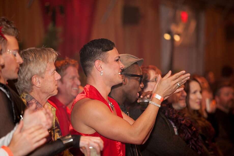 Guests applaud the contestants on the runway. Photo: Drew Altizer Photography