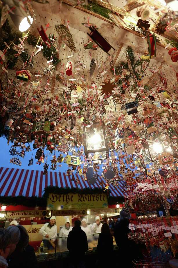 Christmas decorations hang for sale at a stand at the traditional Christmas market 'Nuernberger Christkindlesmarkt' ahead of the opening ceremony on November 30, 2012 in Nuremberg, Germany. Originated in the 16th century the Nuremberg Christmas market is seen as one of the oldest of its kind in Germany. Photo: Johannes Simon, Getty Images / 2012 Getty Images