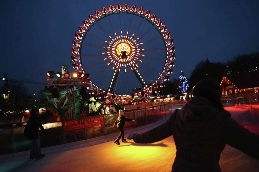 Visitors skate on an ice rink at the annual Christmas market at Alexanderplatz two days after the ma