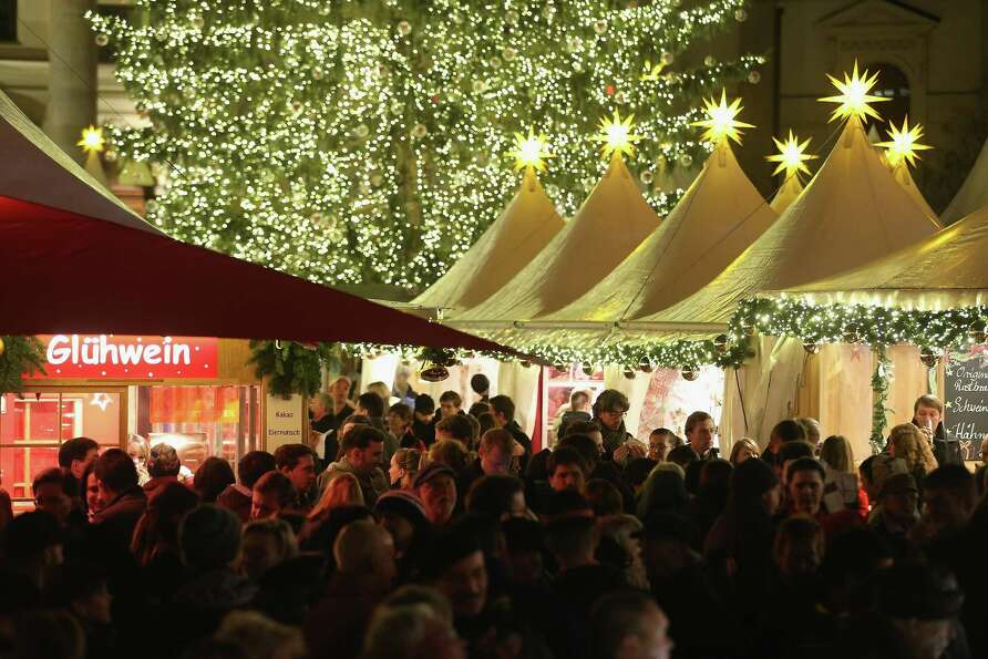 Visitors crowd the annual Christmas market at Gendarmenmarkt on its opening day on November 26, 2012