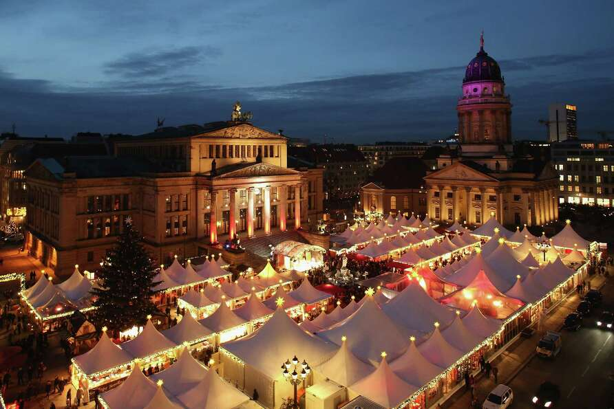 The annual Christmas market at Gendarmenmarkt stands illuminated in the city center on its opening d