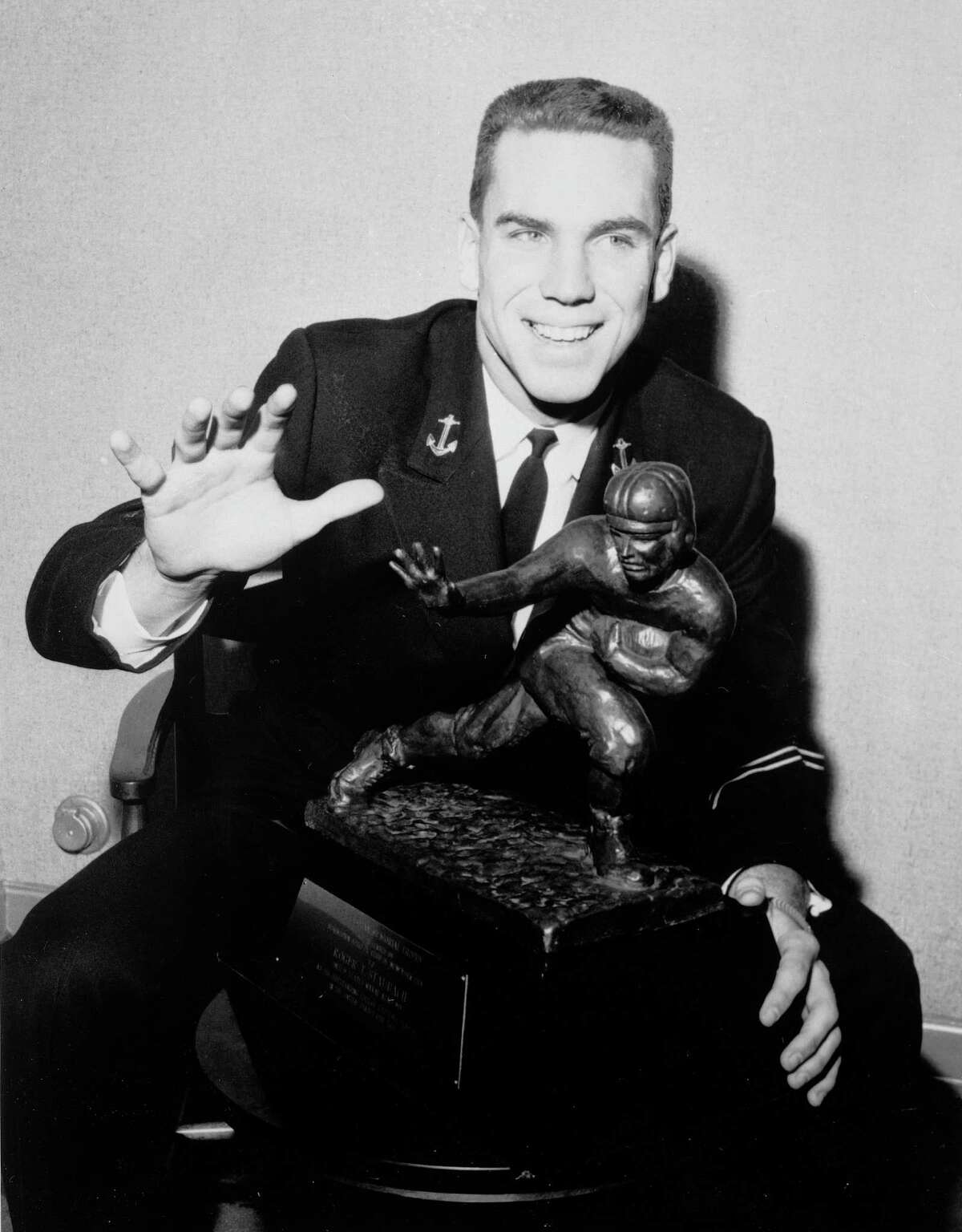 his is a Dec. 11, 1963, file photo showing Roger Staubach, Navy quarterback, posing with the Heisman trophy in New York, prior to receiving the award formally at a luncheon. The Navy quarterback went on to the 1964 Cotton Bowl, completing a then-record 21 of 31 pass attempts for 228 yards, but his second-ranked Midshipmen lost the National Championship battle to No. 1 Texas, 28-6. Source: attcottonbowl.com