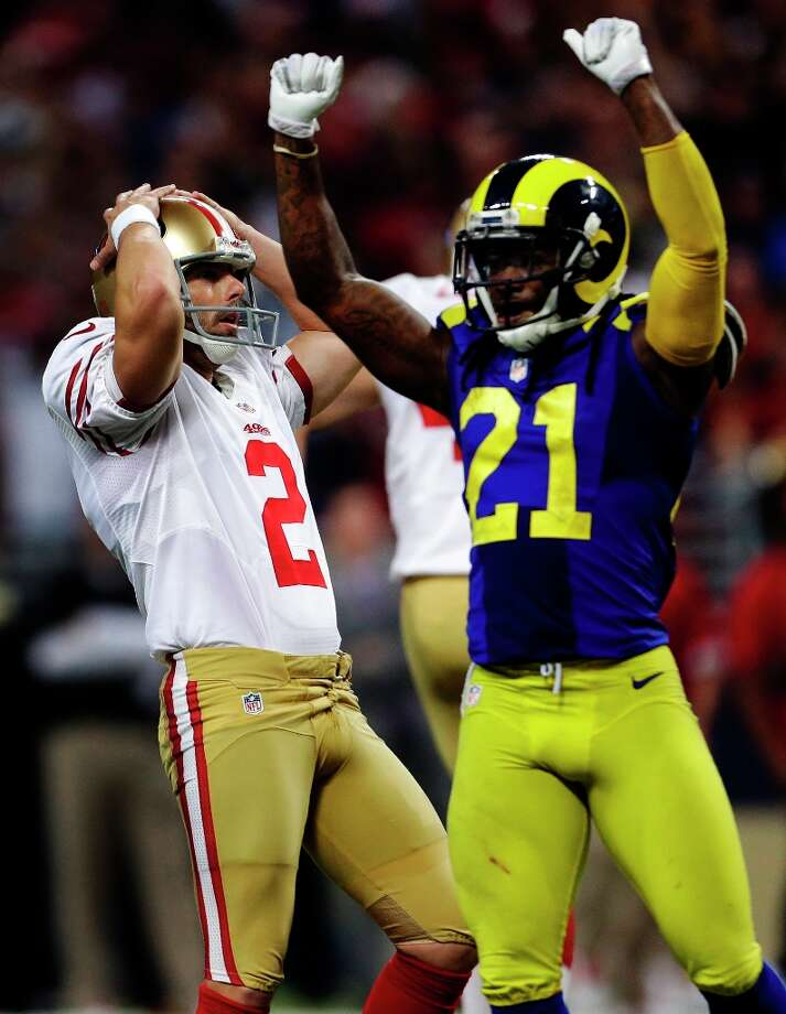 San Francisco 49ers kicker David Akers, left, and St. Louis Rams' Janoris Jenkins react after Akers missed a 51-yard field goal attempt in overtime of an NFL football game, Sunday, Dec. 2, 2012, in St. Louis. The Rams won 16-13. Photo: Jeff Roberson, Associated Press / AP