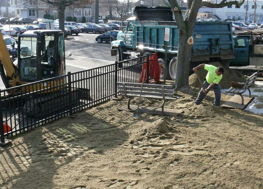 Employees from G Pic & Sons Construction Co. prepare the patio at the New Haven-bound side of the downtown train station. The brick patio is being replaced with concrete pavers. Photo: Genevieve Reilly / Fairfield Citizen
