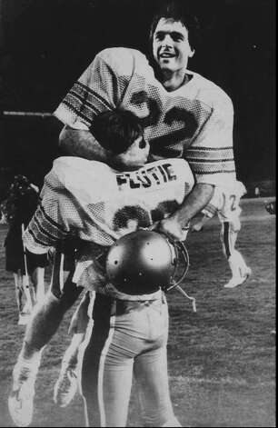 Boston College quarterback Doug Flutie rejoices in his brother Darren's arms after B.C. defeated the Miami Hurricanes with a last second touchdown pass, in Miami, in this Nov. 23, 1984 photo. Flutie won the Heisman that year and the Boston College quarterback led his Eagles to a 45-28 victory over Southwest Conference Champion Houston in the 1985 Cotton Bowl, which remains the highest-scoring Cotton Bowl ever played. Source: attcottonbowl.com Photo: AP / AP