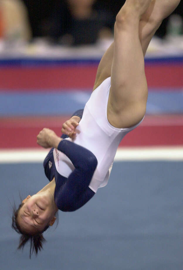 Amy Chow is grounded now that she is out of gymnastics. Chow is a licensed physician and surgeon.  Photo: SMILEY N. POOL, HOUSTON CHRONICLE / HOUSTON CHRONICLE