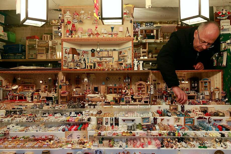 NUREMBERG, GERMANY - NOVEMBER 30:  A toy seller arranges his goods at the traditional Christmas market 'Nuernberger Christkindlesmarkt' ahead of the opening ceremony on November 30, 2012 in Nuremberg, Germany. Originated in the 16th century the Nuremberg Christmas market is seen as one of the oldest of its kind in Germany. Photo: Johannes Simon, Getty Images