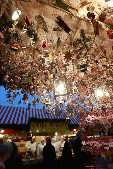 NUREMBERG, GERMANY - NOVEMBER 30:  Christmas decorations hang for sale at a stand at the traditional