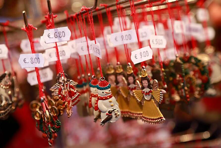 Christmas decorations hang for sale at a stand at the traditional Christmas market 'Nuernberger Chri