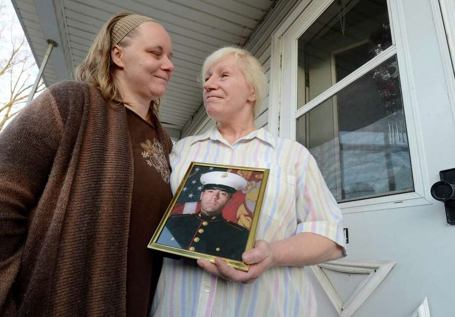 Mary Morgan, right is joined by her daughter Maria Betts on the front porch of her home in Mechanicville, N.Y. Dec 3, 2012 as she holds a photo of her son Anthony Denier who was killed in Afghanistan yesterday.    (Skip Dickstein/Times Union) Photo: SKIP DICKSTEIN